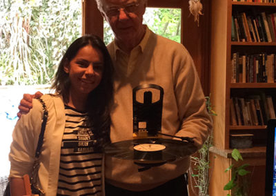 Bob Proctor showing Alpa Pandya his infamous battery operated portable record player
